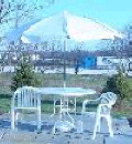 Where to rent 42  WH MESH TABLE W UMBRELLA in Louisville KY